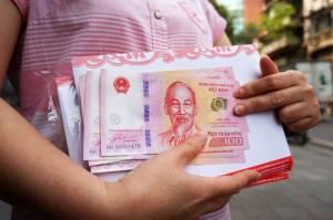 100 đồng kỷ niệm 65 năm ngày thành lập NHNN Việt Nam có folder