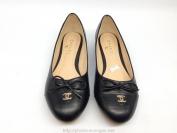 Giày bệt nữ Chanel màu đen có nơ