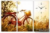 Tranh đồng hồ treo tường xe đạp dưới nắng hoàng hôn AmiA 1455